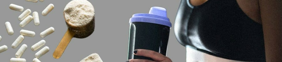 A woman holding a creatine filled drink
