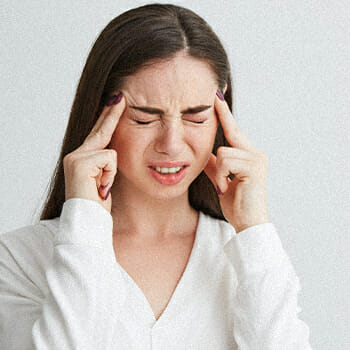 A woman having a headache