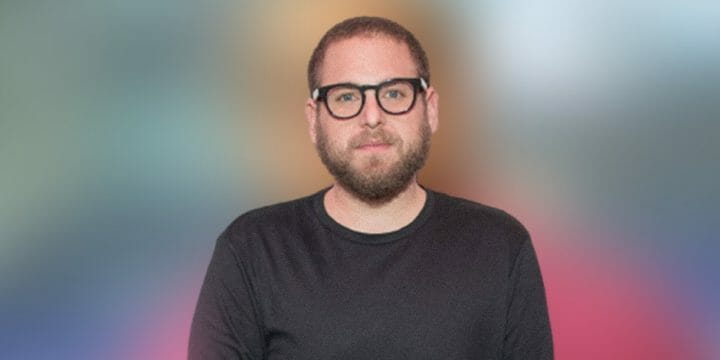 Jonah Hill smiling in front of the camera