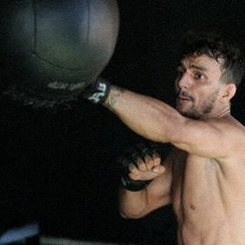 A guy punching and training for boxing
