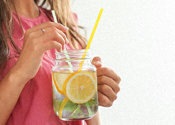A person drinking a lemonade