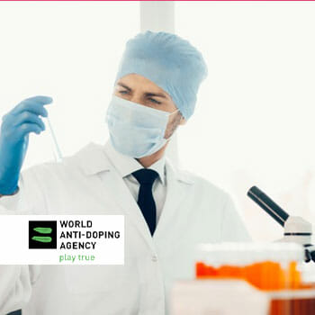 medical personnel testing out a sample with WADA Logo
