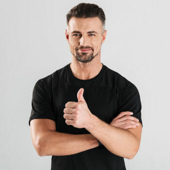 man in a black shirt with his hands in a thumbs up
