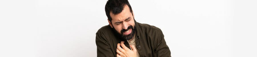 bearded man experiencing chest pains