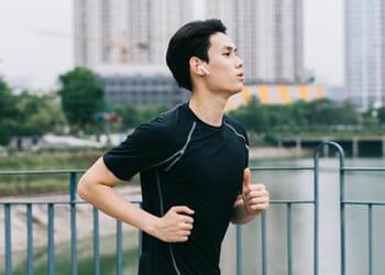 asian man jogging at a park