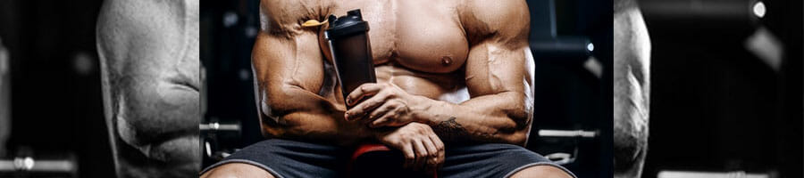 shirtless man with big muscles holding a water jug