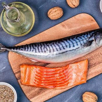 salmon fish, oil and seeds in a table