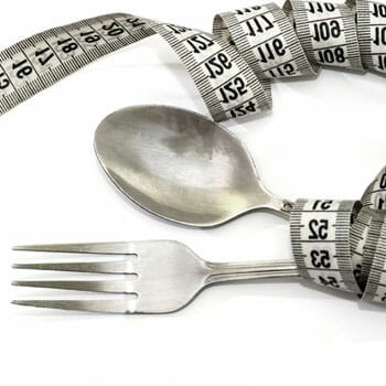 measuring tape wrapping both spoon and fork