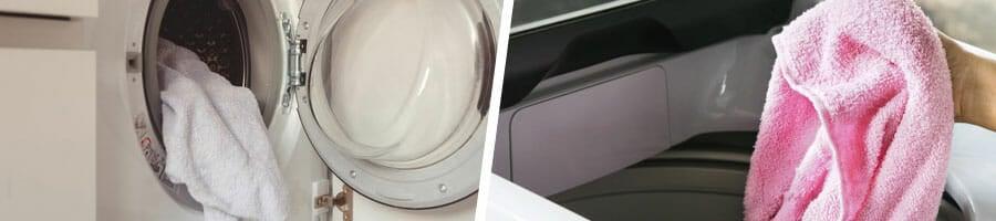 washing machine with clothes inside, pink towel inside a washing machine