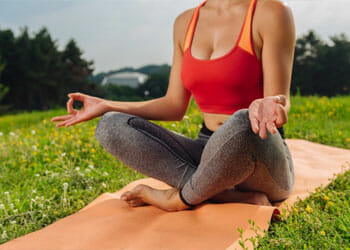woman in a seated yoga position