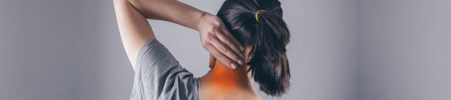woman holding her nape in pain