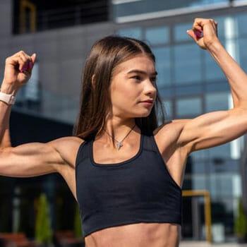 woman flexing her biceps