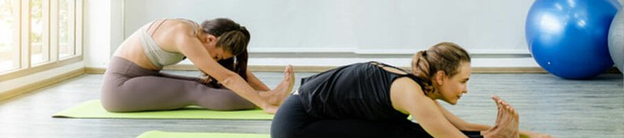 two ladies doing a yoga pose