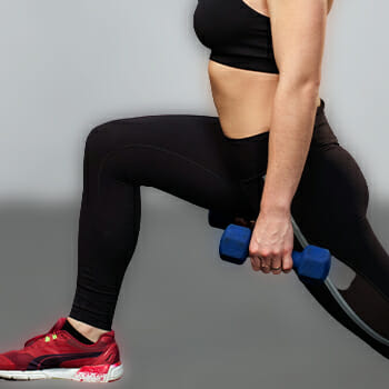 Woman doing walking lunges exercise
