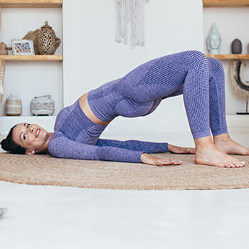 A woman doing the glute bridge exercise