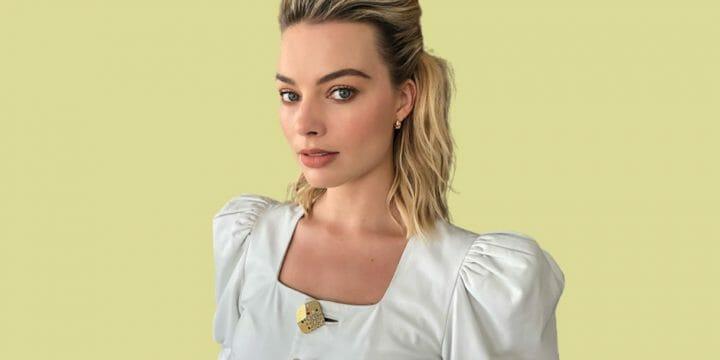 Margot Robbie in yellow background