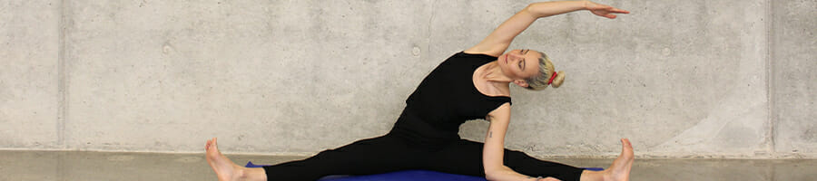 A woman in split position and stretching