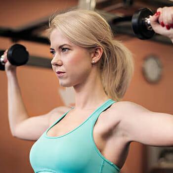 A woman doing a shoulder press