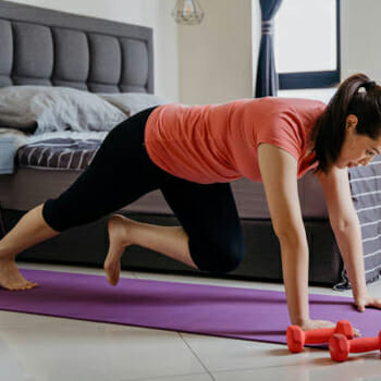 A person doing the slow mountain climber exercise indoors