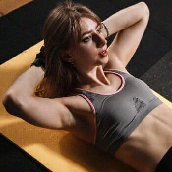 Woman doing sit ups workout