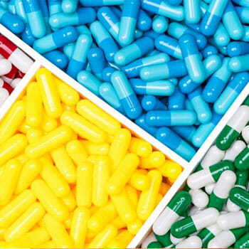 stack of pills organized by color