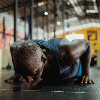 black man in a push up position