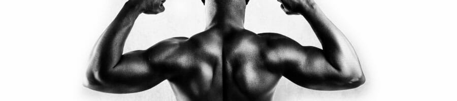 black man in black and white showing off his back muscles