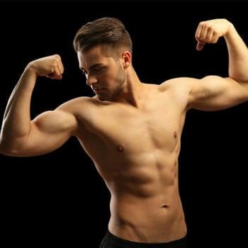 shirtless man showing off his biceps