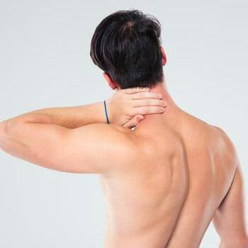 man showing his back and grabbing his nape