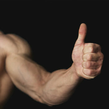man with big biceps giving a thumbs up