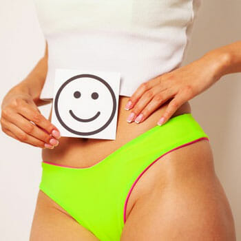 woman wearing undies showing her stomach and a smiley drawing