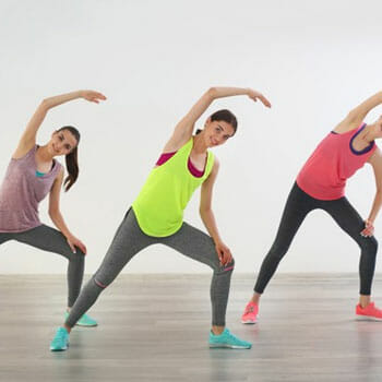 a group of women doing aerobic workout