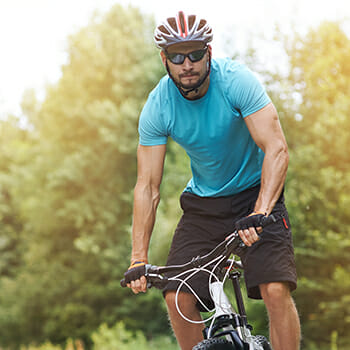 A man riding bicycle outdoors