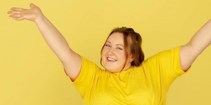 A happy woman in yellow shirt