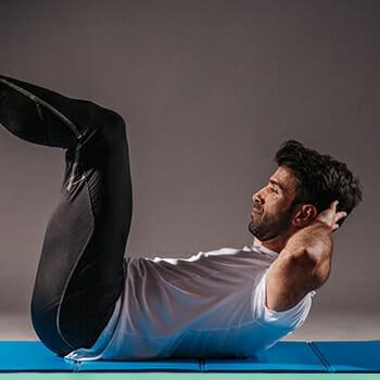 A man performing abdominal crunches