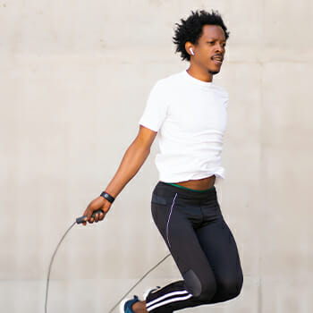 A person doing jump rope in motion