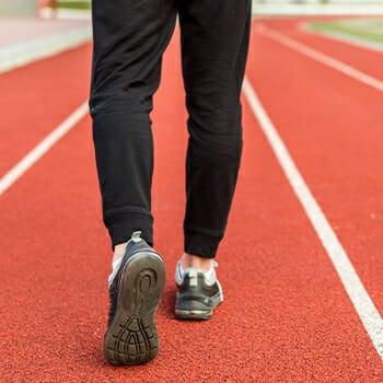 Man walking in red race track