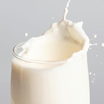 A glass of whole milk dairy splash