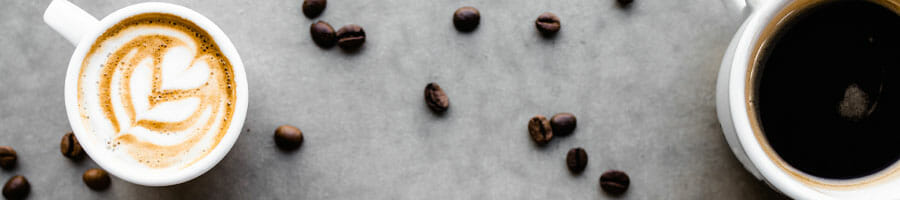 coffee mugs and coffee beans on a gray background