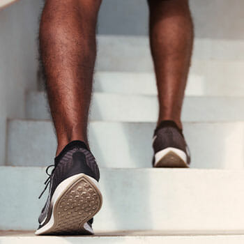 rubber shoes view of a person using a stairs