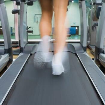 leg view of a woman running on a treadmill