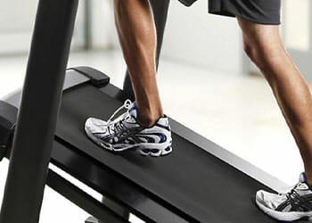 feet view of an inclined treadmill