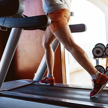 person using a treadmill running