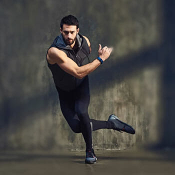 man doing skater exercise in gym clothes