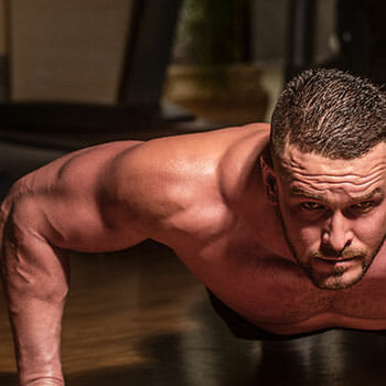 shirtless man working out