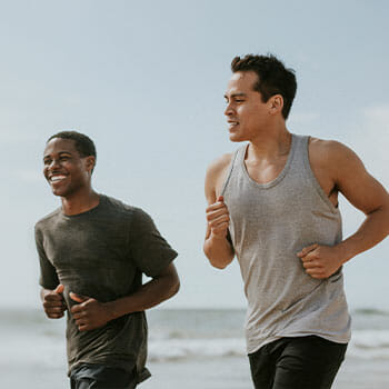 two males jogging outdoors