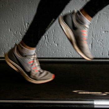 running rubber shoes on a treadmill