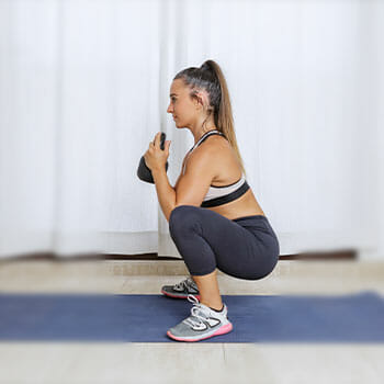 woman in a goblet squat position