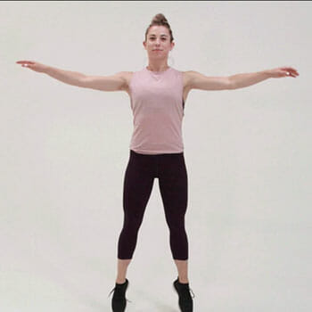 woman in a jumping jack position