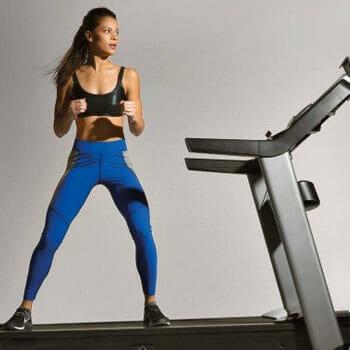 woman walking sideways on a treadmill